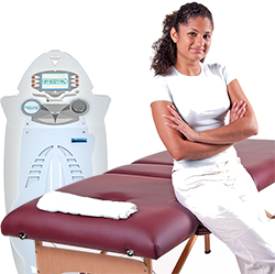Massage table with proud masseuse folding arms leaning on it with copy space